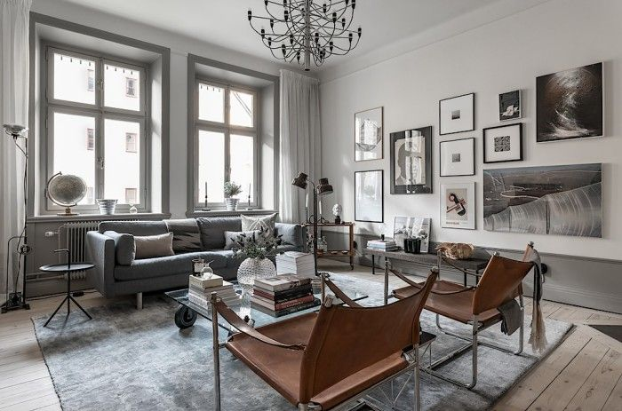Chic livingroom: cognac leather, details and persian silk rug