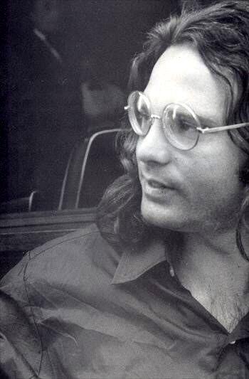 Jim Morrison in Paris, 1971. Rare glasses shot.