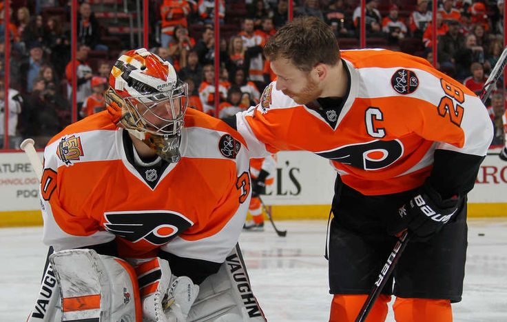 PHILADELPHIA, PA - APRIL 01: Michal Neuvirth #30 and Claude Giroux #28 of the Philadelphia Flyers chat during warmups prior to their game against the New Jersey Devils on April 1, 2017 at the Wells Fargo Center in Philadelphia, Pennsylvania. (Photo by Len Redkoles/NHLI via Getty Images)