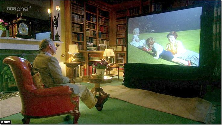 """And here, Prince Charles looks at old home movies for a special about """"My ma-ma"""" as he calls her.  You can see it's the same red leather chair from the 1850s.  Wow."""