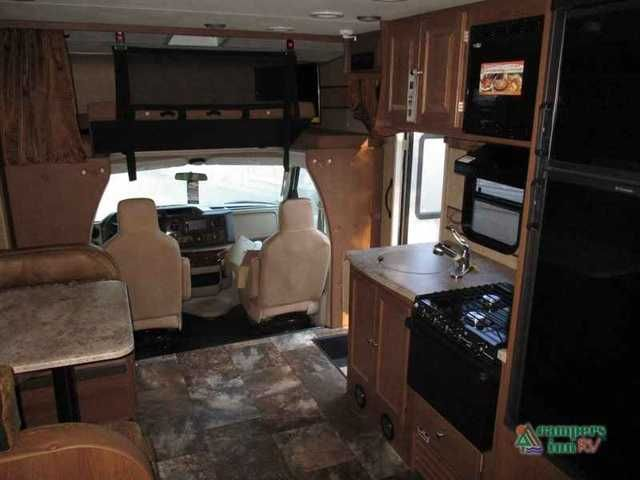 2016 New Coachmen Rv Leprechaun 220QB Ford 350 Class C in Virginia VA.Recreational Vehicle, rv, 2016 Coachmen RV Leprechaun 220QB Ford 350, Enjoy traveling in this Leprechaun class C motorhome 220QB by Coachmen RV. This unit features a single slide to add interior space and comfort, plus all the amenities you need are at your fingertips whenever you decide to go.Notice the slide out u-shaped dinette opposite the door, or you can choose optional recliners. There is also a pantry and wardrobe…