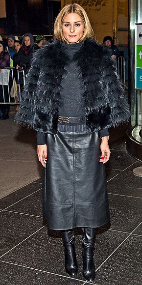 OLIVIA PALERMO We're all for keeping warm during the chilly winter months, but in this oversize fur/turtleneck/long leather skirt/leather boots combo, it's hard to tell where Olivia ends and her outfit begins.
