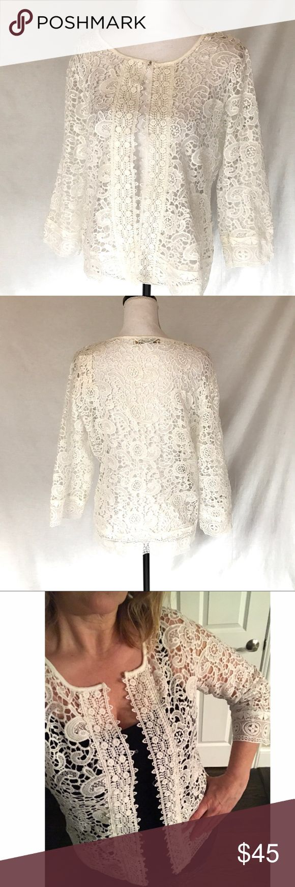 "NWT White Lace 3/4 Sleeve Open Cardigan Large New with tag white lace Open Cardigan.  3/4 length sleeves.   Hook at neckline in front.  Garment tag says size 40.  Paper tag says 42.    It feels like it fits like a Large to me.  Please check measurements before buying.  Approx measurements:  chest across laying flat 21"", length 23.25"".   100% polyester. Evarosa Sweaters Cardigans"
