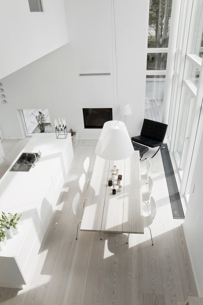 Danish kitchen/dining room-pale wood floors with all the white