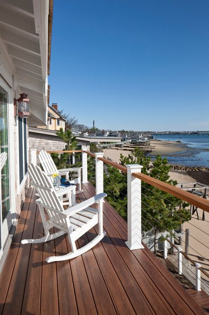 trex decking prices Deck Beach with Adirondack chairs balcony cable railing coastal deck eaves lanterns