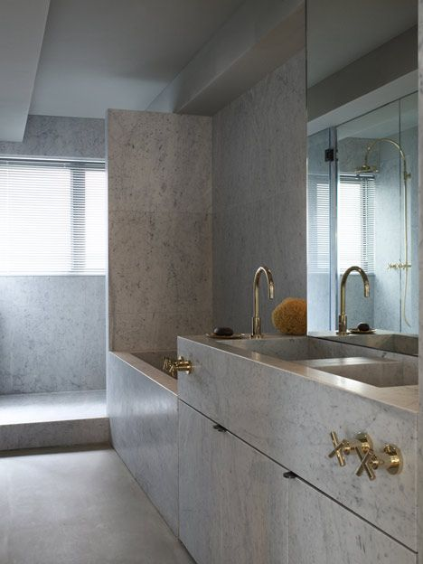 Ilse Crawford bathroom, stone, brass faucets