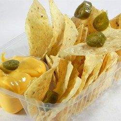 "Nacho Cheese Sauce | ""Here's a simple cheese sauce to spread over tortilla chips. Add some jalapenos to spice things up a bit."""