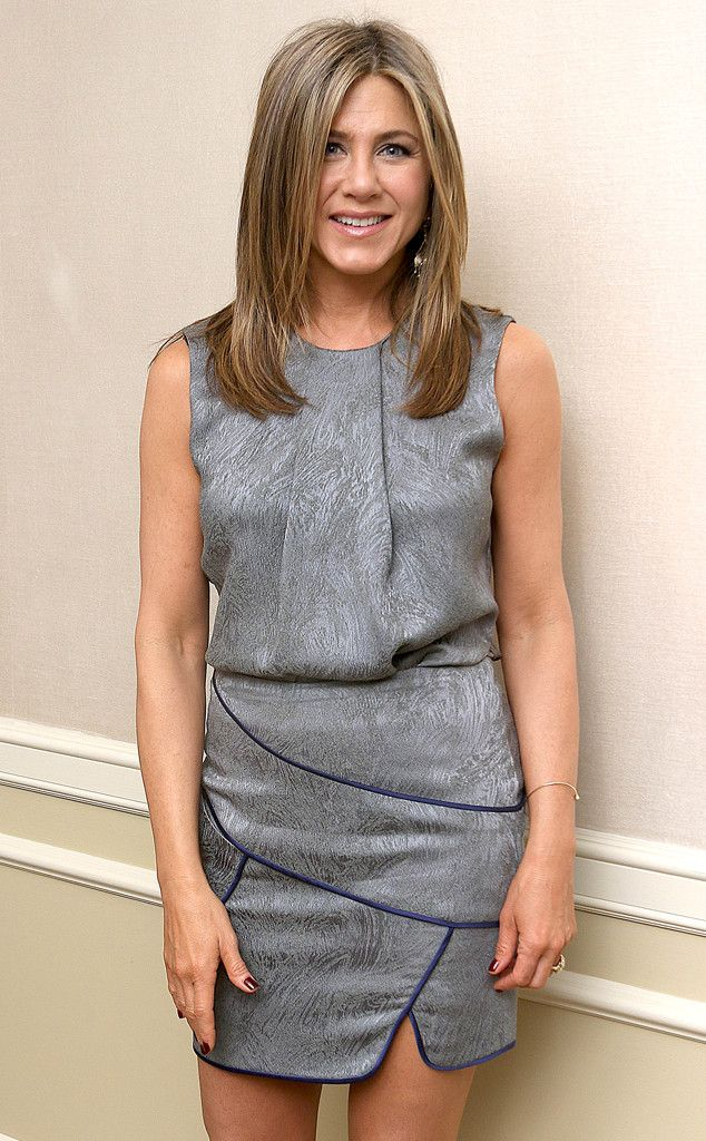 Jennifer Aniston appears at a press conference in this GORGEOUS grey mini dress!