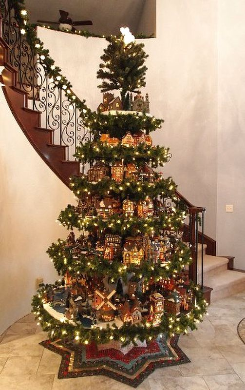 Now this is an idea if I ever have a bigger house.... add shelves between sections of a tree to display nativity scenes