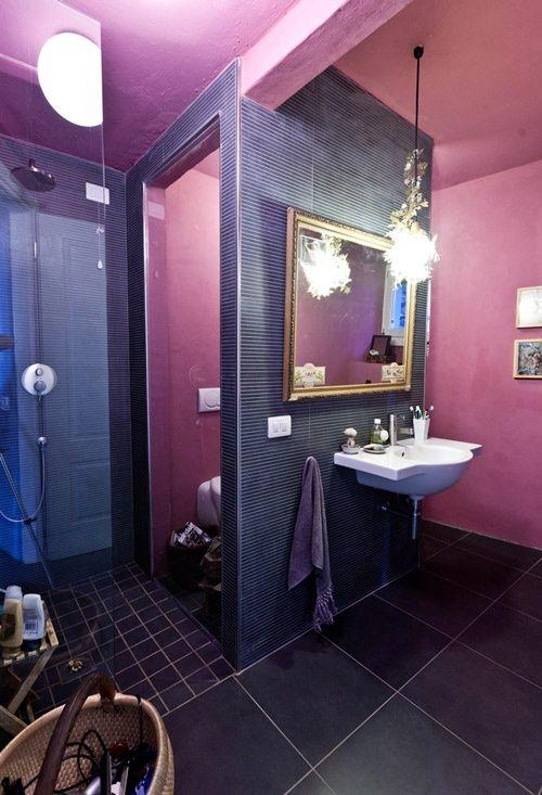 purple bathroom design with unique hanging lamp