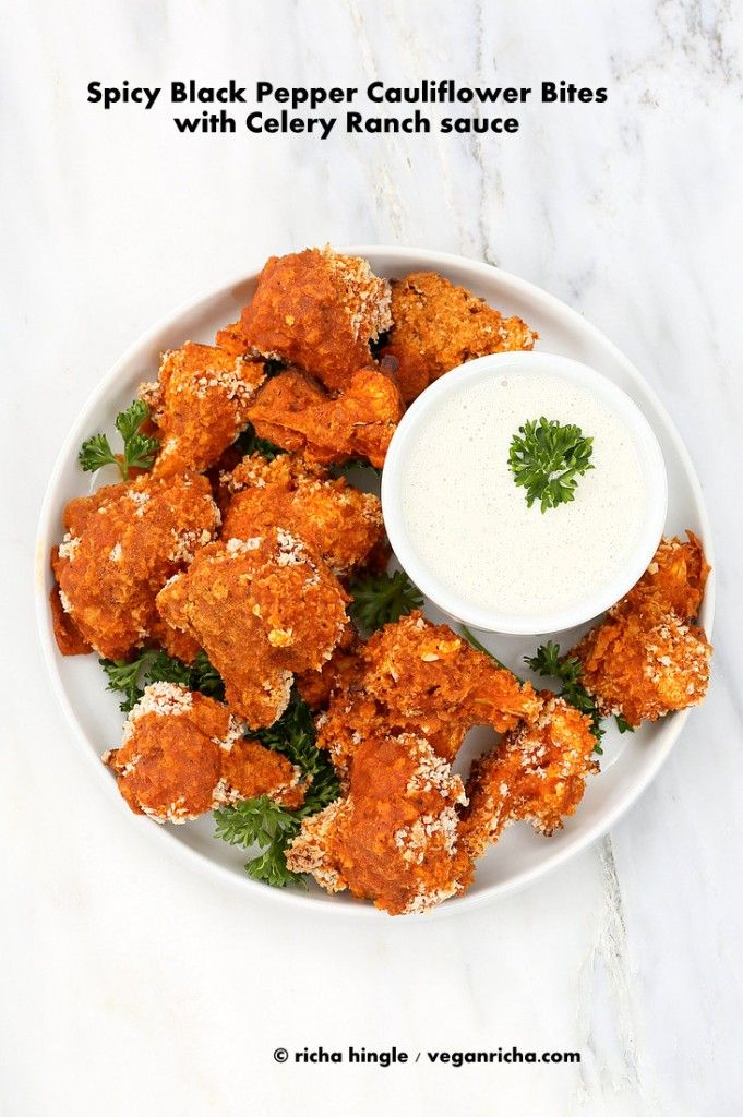 These Spicy Baked Cauliflower Bites are easy & spicy. Hot sauce+ black pepper+cayenne, all the heat u need for gameday. Serve with a celery ranch sauce. vegan soy-free