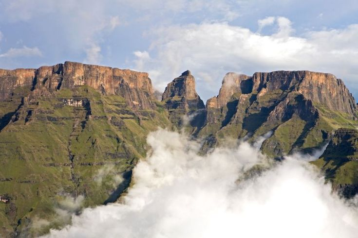 The 3 most prominent peaks in the central Drakensberg area: Champagne Castle, Monk's Cowl and Cathkin Peak.