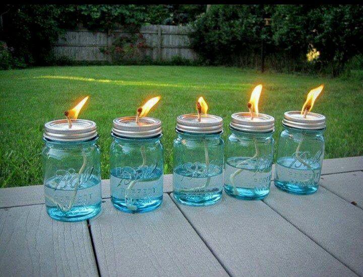 Mason jars, Cotton string & liquid citronella for back yard mosquito repellent lamps.