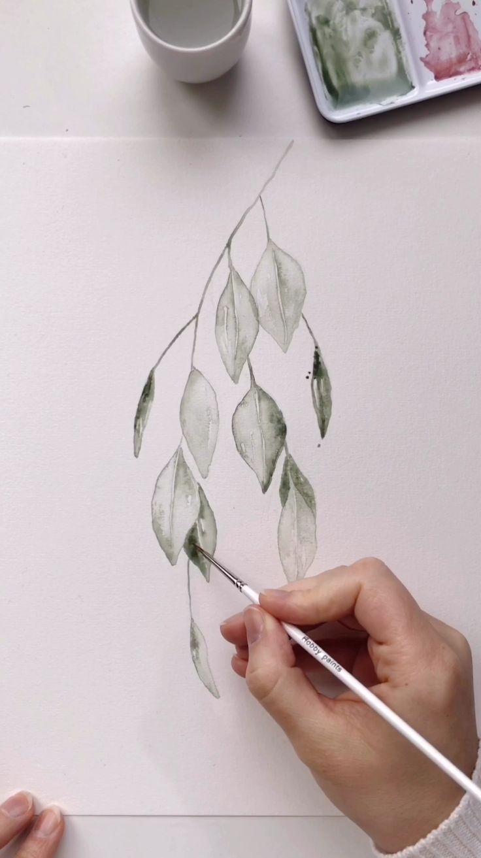Zeitraffer von Skyla Design beim Malen von hellgrünen Aquarellblättern …