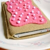 An iPod cozy made of brown felt with pink faux frosting and sprinkles on top. DIY for teens