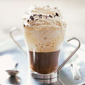 Add cream, kahlua, and vodka to a pressurized whipped cream dispenser.* Shake the dispenser 3 to 4 times, then dispense on top of each hot espresso shot (it will come out like whipped cream). Top with  grated coffee beans.