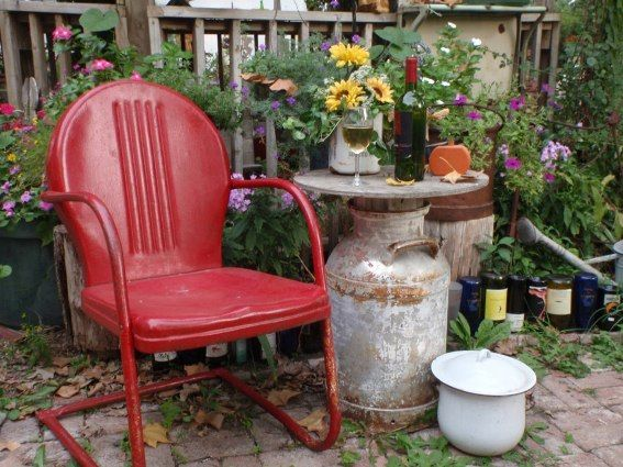 Red Bistro chair paired with an antique milk can turned side table.