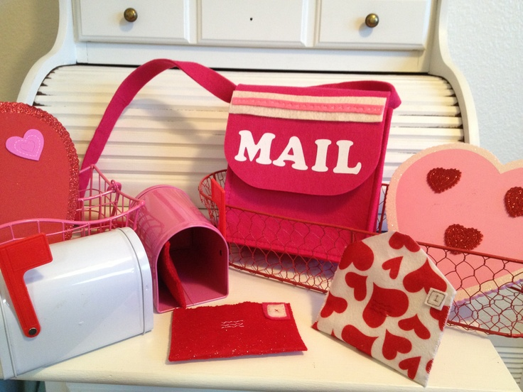 Valentines mail sorting activity for valentine preschool party with felt mail bags and sewn envelopes. www.littlebirdcelebrations.com