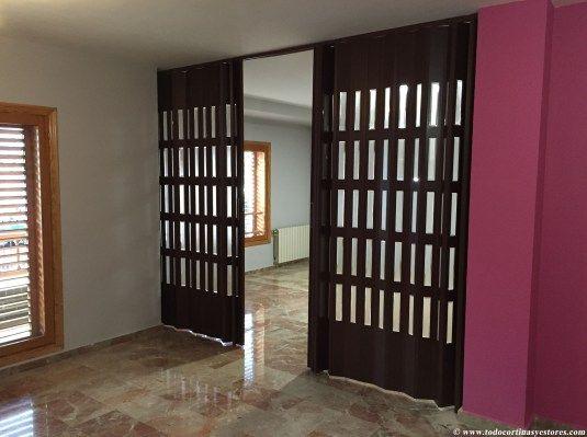 Puerta Plegable de PVC sapely con vidrieras separacion de espaci