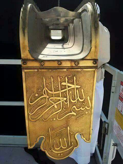 A rare up close view of the Meezab  al  Rahmah  - the golden water  spout on the kabah # Mecca
