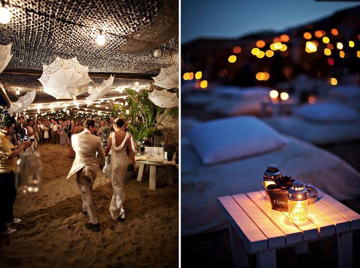 The couple walks on the sand...the beautiful reception venue @Nancy Amos