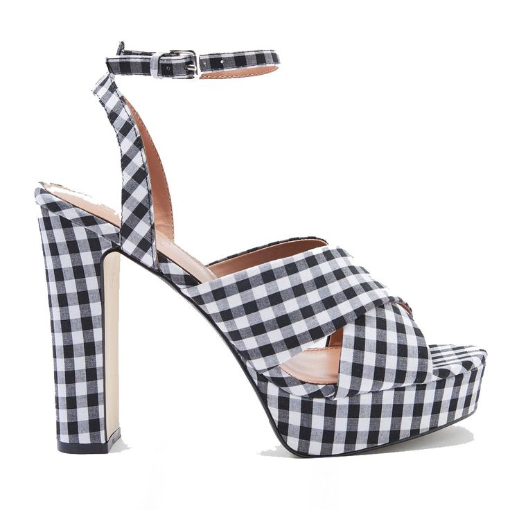 Coveteur Editors Share the Sandals They're Buying This Summer: Whether you're a fan of a minimalist leather slide or loading up on studs, we've rounded up the best summer shoes that we're adding to our checkout carts. --Topshop madrid gingham cross strap platform heels | coveteur.com