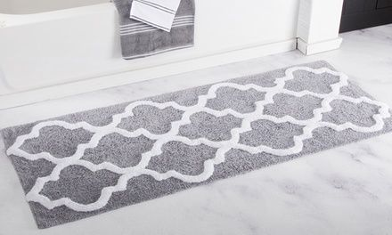 Contemporary bath mat with a trellis pattern is crafted from super-absorbent Egyptian cotton and features an anti-skid latex backing