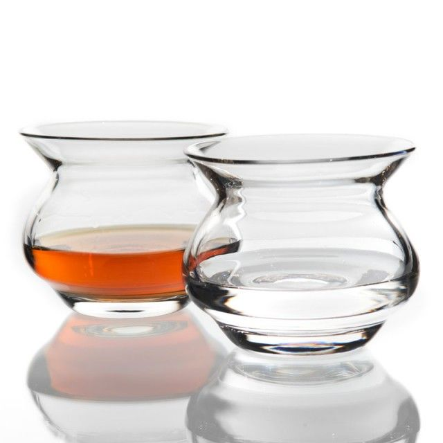 An innovation in spirit glassware, a scientifically engineered drinkware piece that was designed to naturally enhance any liquor or alcoholic beverage.  In any traditional glass, concentrated spirit aromas are known to burn the nostrils, but the concave hourglass shape and wide mouth design of this glass precisely dissipates forceful alcohol vapors. This unique design allows for the subtle hidden flavors to be uncovered and gently experienced.