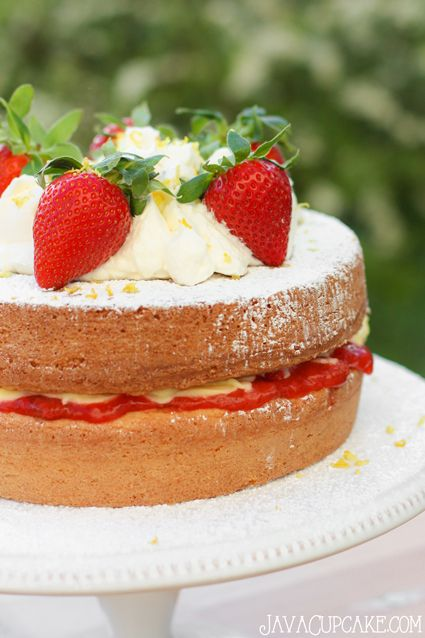 Victoria Sponge Sandwich Cake with vanilla pudding & fresh strawberry filling topped with fresh whipped cream, lemon zest and more strawberry!