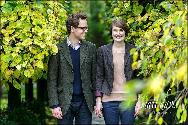 Vibrant autumnal colours make a great Engagement Photo taken in the gardens of Barnsley House Gloucestershire
