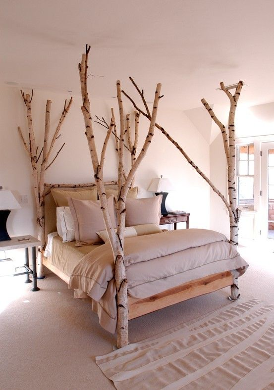 AN IDEA - the tree branch bed posts are so eye catching, they make the room  come alive; love it! you could hang stuff on it too:) I made one years ago  ...