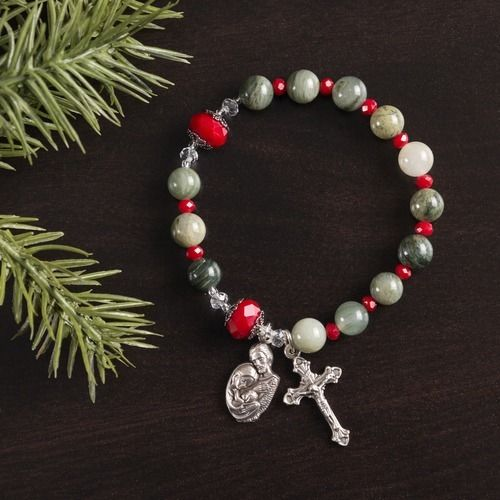 This Special Edition Stretch Fit Rosary Bracelet Strings Together Richly Seasonal Beads Of Jade And Holly Red Complimented By Thoughtful Bead C