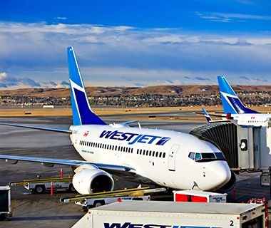 WestJet aircraft parked at Calgary International Airport in Alberta, Canada