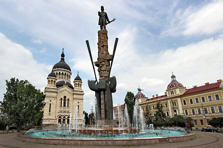 Dormition of the Theotokos Orthodox Cathedral and Avram Iancu Statue in Cluj-Napoca, Romania
