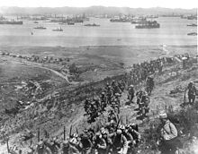 """168.The ANZAC troops, along with the regular British 29th Division, the Royal Naval Division and the French Oriental Expeditionary Corps, consisting of """"metropolitan"""" and colonial troops, were subsequently placed under Hamilton's command. Pin depicts French troops landing at the campaign staging post the Greek Island of Lemnos"""