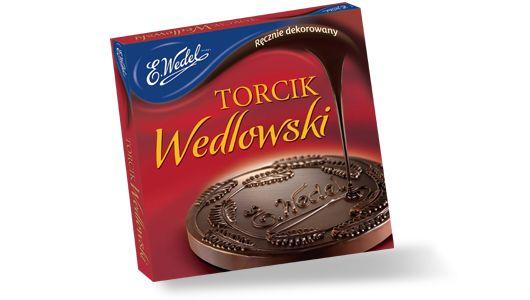 Medallón de waffle decorado a mano con chocolate semi-amargo. Este postre artesanal se ha convertido en un símbolo durante generaciones, considerado un clásico de la chocolatería polaca.