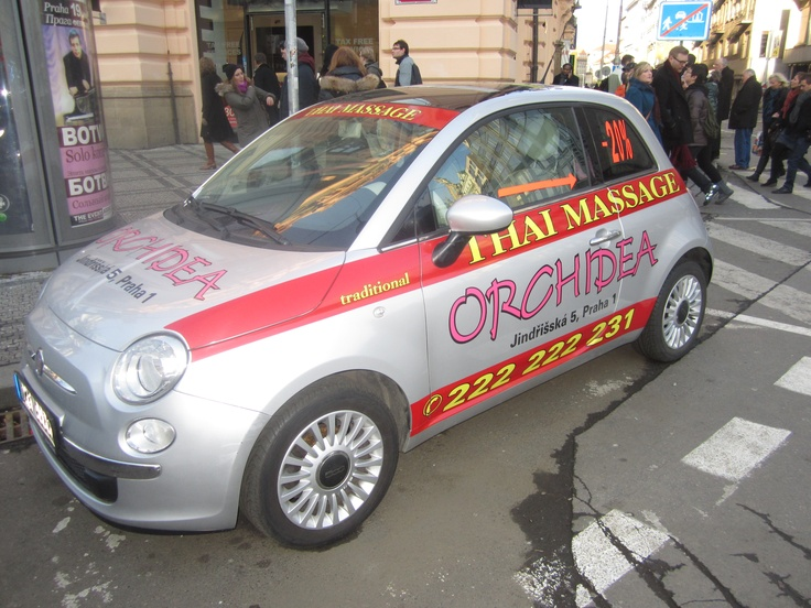 Nothing says ''relaxing massage'' like a Fiat 500 covered in pink stickers.