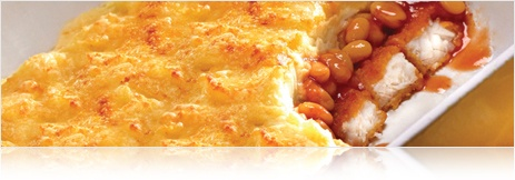Fish fingers (cooked), pour over some baked beans and top with a smooth mash, bake till the top is golden.  Add herbs and seasoning, cheese (?) to the mash if you want to be fancy.