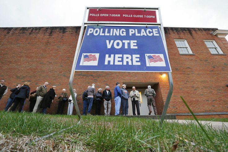 Voters wait in line for a polling place to open at Eastland Baptist Church in Greenville, South Carolina for the Republican presidential primary on February 20, 2016. South Carolina became the third state in a row this year to have a record-high turnout for the Republican primary.