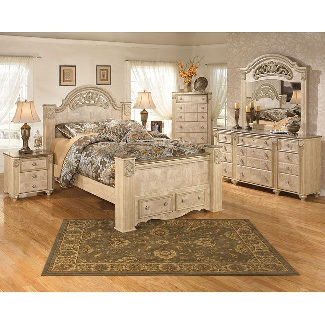 ashley furniture stanwick king faux leather upholstered sleigh bed with the old world beauty of the crisp parchment light opulent finish flowing over