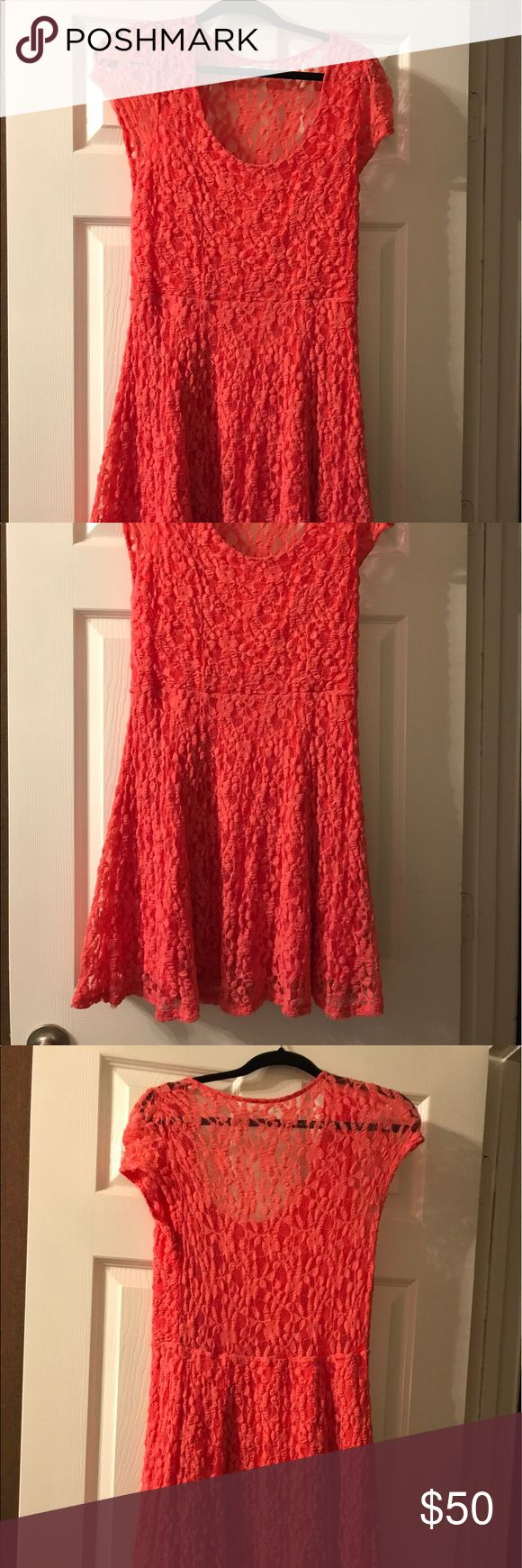 Urban Outfitters coral lace dress Beautiful coral lace dress from Urban Outfitters. Everything except the back is lined. I wore it with a coral tank top. Very cute and comfortable too. Urban Outfitters Dresses Mini