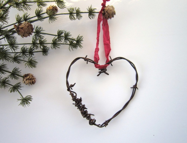 any color ribbon hang from a tree for shabby chic western wedding!! Christmas in July Heart Ornaments Christmas ornaments Rustic Christmas Wedding decor wedding favor Cowboy barbed wire heart. $15.00, via Etsy.