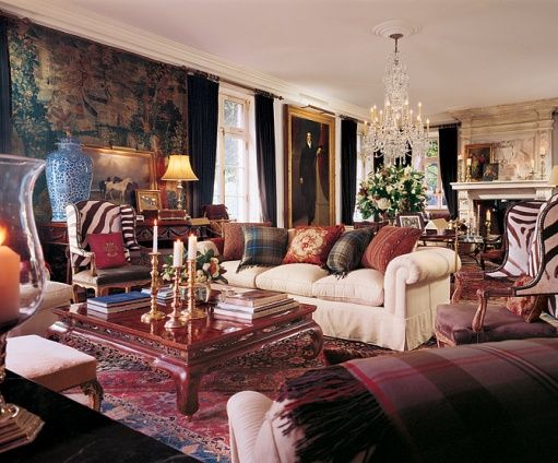 Beautiful display of rich navy's and burgundy's make the living room feel inviting and not stuffy though its definitely a formal feeling room - Ralph Lauren home.