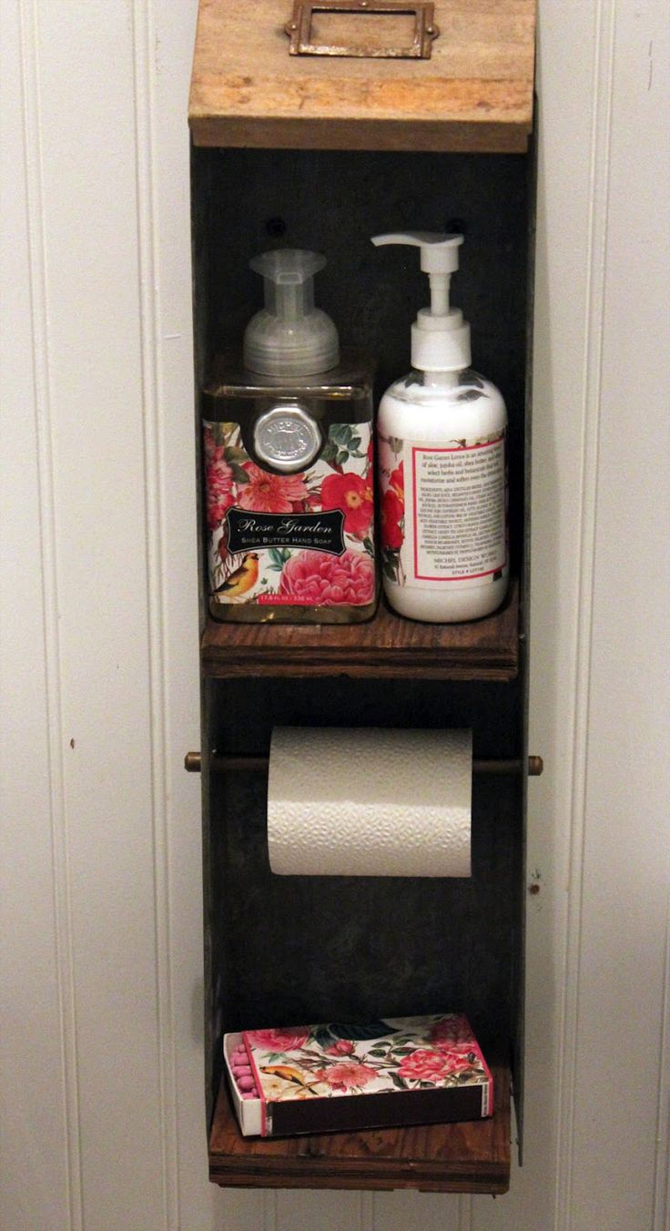Old drawer as a toilet paper holder.  This is genius.