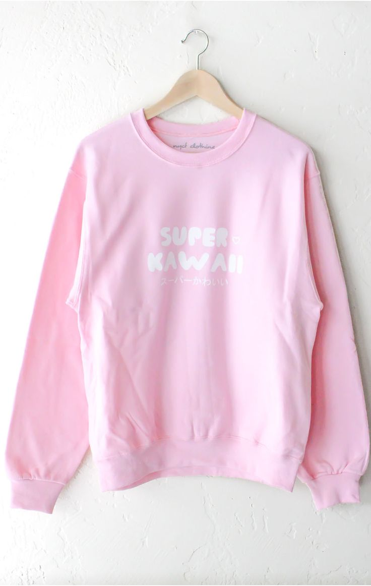 "- Description - Size Guide Details: Super Kawaii oversized sweater in pink. Oversized, Unisex fit. Brand: NYCT Clothing. 50% Cotton, 50% Polyester. Imported. Sizing: 40"" / 101.6 cm width 25"" / 63.5 cm"