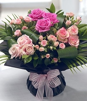Venice - Elegant and stunning in design, this Valentine's Day Rose bouquet features striking Palm and Aspidistra leaves.