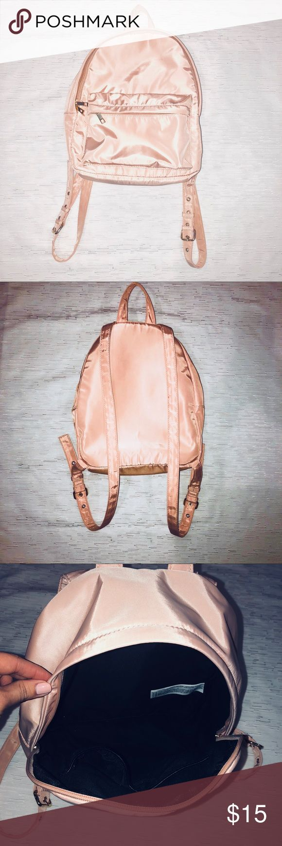 "Forever 21 - light pink small back pack Forever 21 - Small light pink backpack.  Gold color hardware.  Adjustable straps.  14""H x 12"" L (approx). 1 exterior zip up pocket and two interior pockets. In excellent used condition, worn once! From pet and smoke free home. Forever 21 Bags Backpacks"