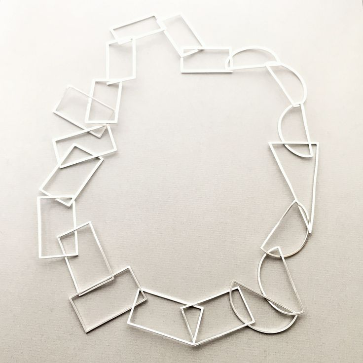 Sterling silver statement necklace made from interlocking rectangles, semi circles and triangles.  Approximately 70cm in length, the necklace fits comfortably over the head without the need for a clasp.