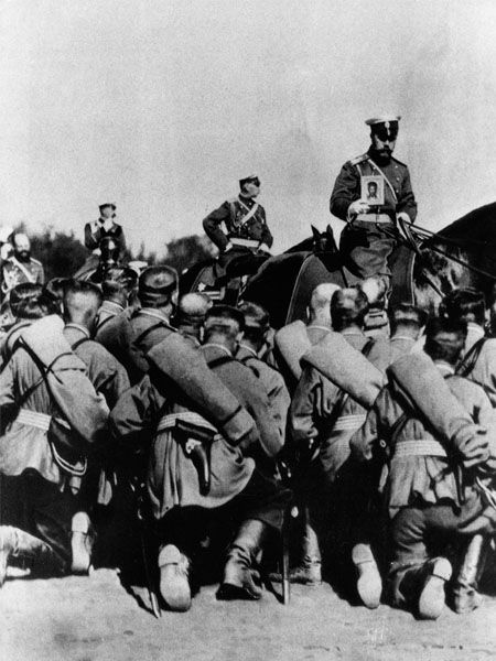 Tsar Nicholas II, on horseback holding an icon, during prayers before a battle at the front on the Eastern Front. As the last Emperor of Russia, Nicholas II ruled the country from 1894 until his abdication in 1917. Unable or unwilling to leave the country, he and his family were murdered at the hands of the Bolsheviks on the cusp of the 1918 Revolution.