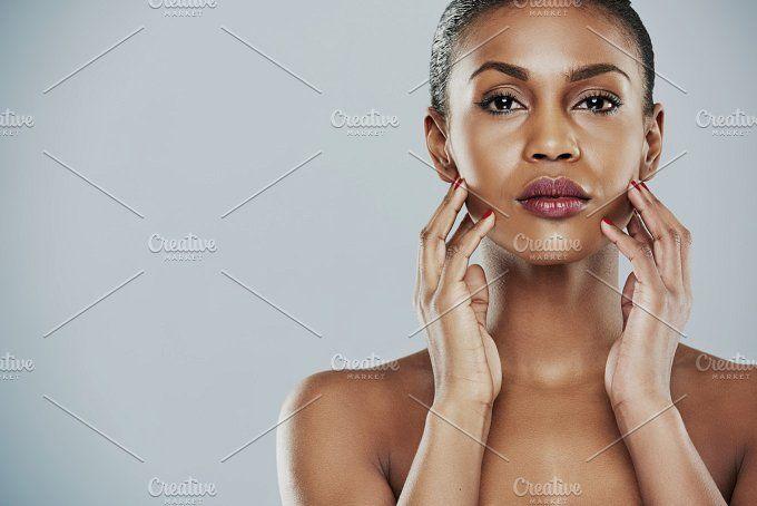Beauty model touching her face by Stefan & Janni on @creativemarket